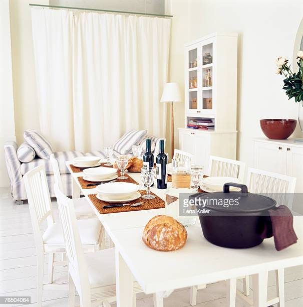 A set table in a white room.