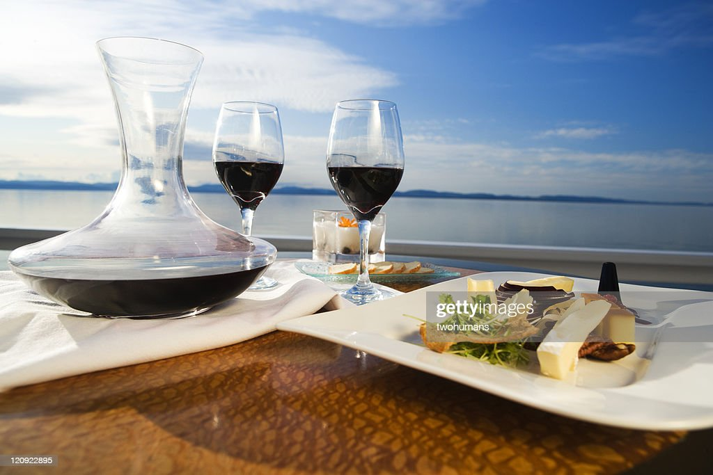 Set table with gourmet appetizer and two glasses on red wine : Stock Photo