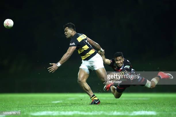 Seta Tamanivalu of Taranaki is tackled by Luteru Laulala of Counties during the round three Mitre 10 Cup match between Counties Manukau and Taranaki...