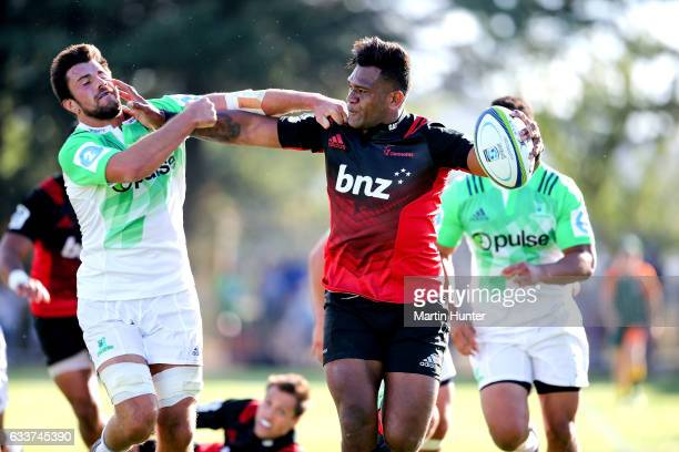 Seta Tamanivalu of the Crusaders breaks away from Josh Dickson of the Highlanders during the preseason Super Rugby match between the Crusaders and...