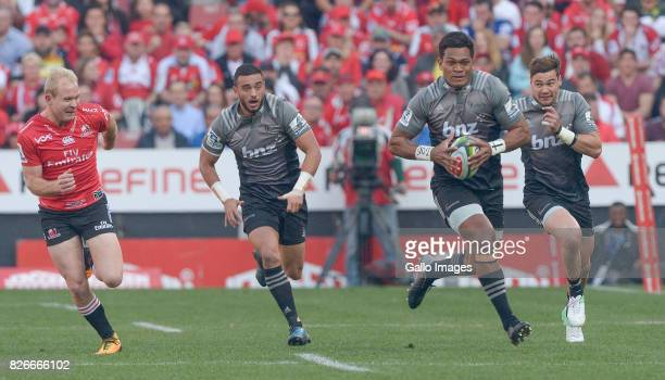 Seta Tamanivalu of the Crusaders breaks the Lions defence during the Super Rugby Final match between Emirates Lions and Crusaders at Emirates Airline...