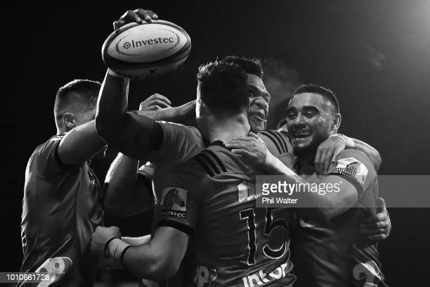 Seta Tamanivalu of the Crusaders celebrates after scoring a try with David Havili and Bryn Hall of the Crusaders during the Super Rugby Final match...