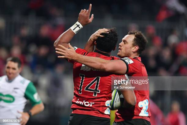 Seta Tamanivalu of the Crusaders is congratulated by Israel Dagg of the Crusaders after scoring a try during the round 19 Super Rugby match between...