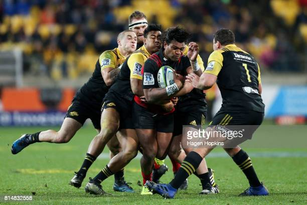 Seta Tamanivalu of the Crusaders is tackled by Julian Savea TJ Perenara and Ben May of the Hurricanes during the round 17 Super Rugby match between...