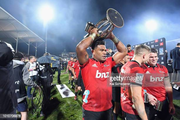 Seta Tamanivalu of the Crusaders lifts the Super Rugby Trophy after the win in the Super Rugby Final match between the Crusaders and the Lions at AMI...