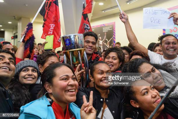 Seta Tamanivalu of the Crusaders presents the Super Rugby trophy to fans during the Crusaders arrival at Christchurch Airport on August 7 2017 in...