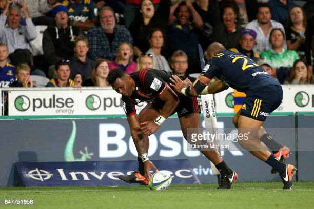 Seta Tamanivalu of the Crusaders scores a try during the round two Super Rugby match between the Highlanders and the Crusaders at Forsyth Barr...