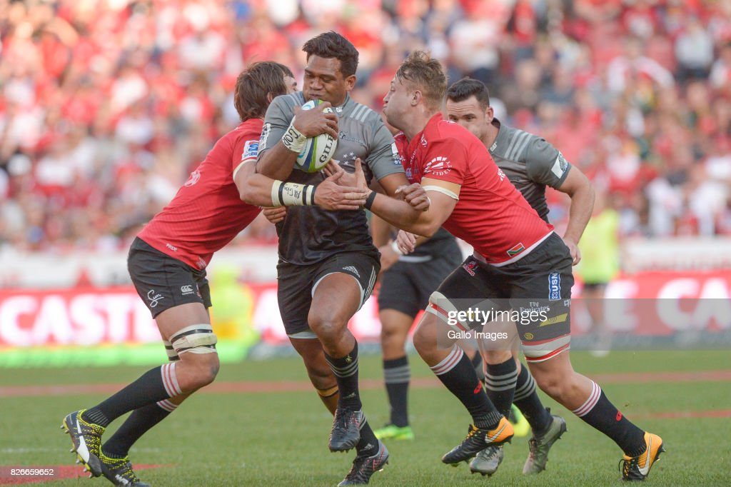 Seta Tamanivalu of the Crusaders tackled by Franco Mostert of the Lions and Ruan Ackermann of the Lions during the Super Rugby Final match between Emirates Lions and Crusaders at Emirates Airline Park on August 05, 2017 in Johannesburg, South Africa.