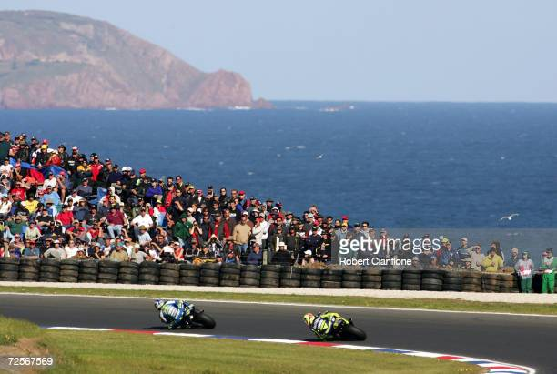 Sete Gibernau of Spain and the Telefonica Movistar Honda Team leads Valentino Rossi of Italy and the Gauloises Fortuna Yamaha during the Australian...