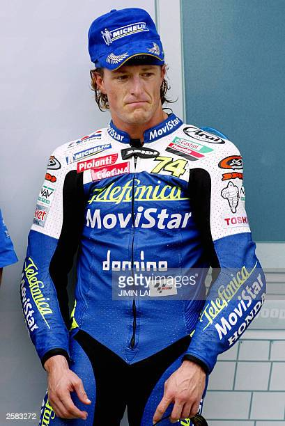 Sete Gibernau of Spain is dejected after losing the race to Valentino Rossi of Italy at the Malaysian Motorcycle Grand Prix in Sepang 12 October...