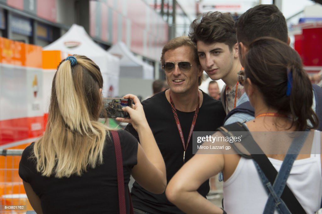 Sete Gibernau of Spain poses for fans in paddock during the MotoGP of San Marino - Previews at Misano World Circuit on September 7, 2017 in Misano Adriatico, Italy.