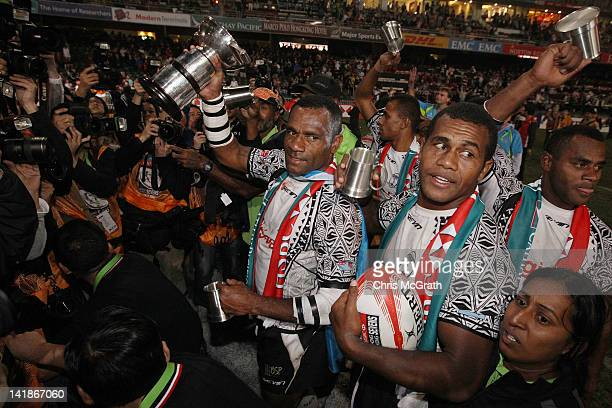 Setefano Cakau of Fiji celebrates with the trophy after defeating New Zealand in the Cup Final between Fiji and New Zealand on day three of the 2012...