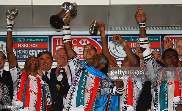 Setefano Cakau of Fiji celebrates with the trophy after victory in the Cup Final match between Fiji and New Zealand on day three of the 2012 IRB Hong...