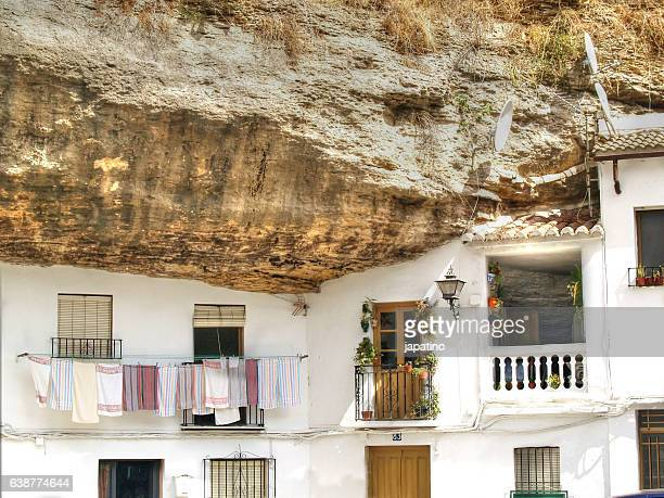 setenil de las bodegas is a spectacular village embedded in the rocks in the sierra de cadiz - setenil de las bodegas stock-fotos und bilder