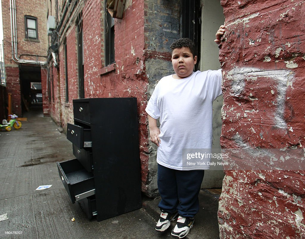 Seth Acevedo, the boy who was allegedly rob and bullied by Wilson Reyes, 7, the kid who was handcuffed and interrogated by police, poses for photos at their home located at 1175 Walton Avenue in the Bronx.