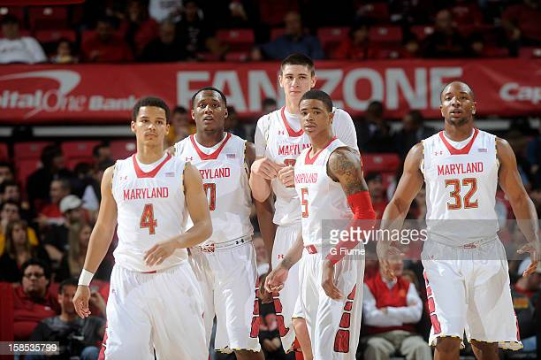 Seth Allen Charles Mitchell Alex Len Nick Faust and Dez Wells of the Maryland Terrapins walk down the court during the game against the LIU Brooklyn...