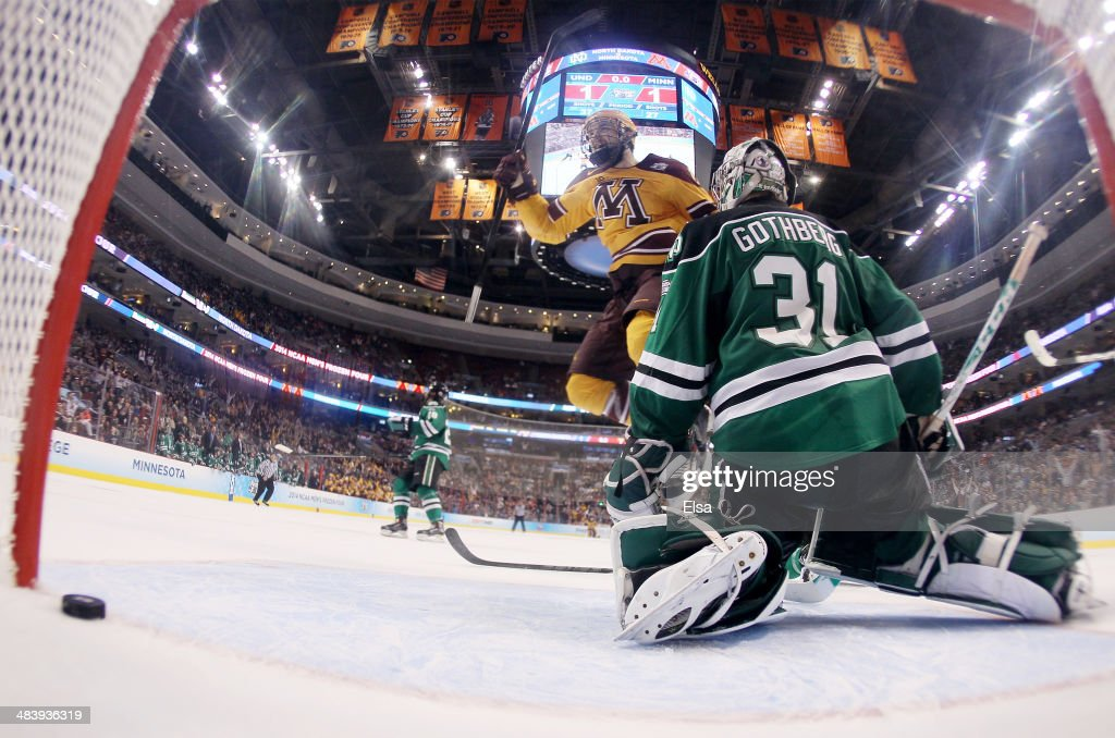 Seth Ambroz #17 of the Minnesota Golden Gophers celebrates teammate Justin Holl's goal with .6 seconds left in the game as goaltender Zane Gothberg #31 of the North Dakota Fighting Sioux looks on during the 2014 NCAA Division I Men's Hockey Championship Semifinal at Wells Fargo Center on April 10, 2014 in Philadelphia, Pennsylvania.The Gophers defeated the Fighting Sioux 2-1.