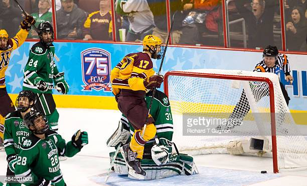 Seth Ambroz of the Minnesota Golden Gophers reacts as the puck is in the net on a winning goal by teammate Justin Holl with only 6 seconds remaining...