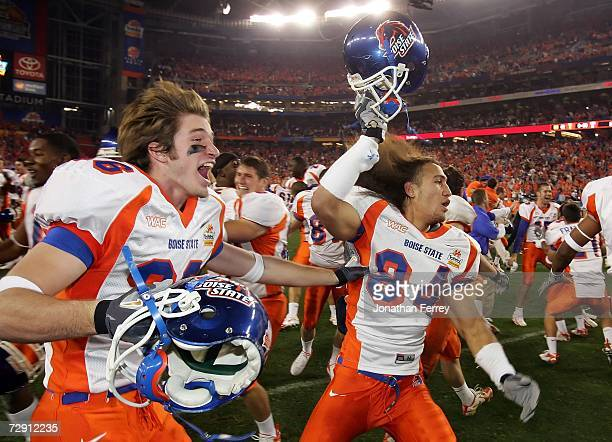 Seth Anderson and Aiona Key of the Boise State Broncos celerbate a win over the Oklahoma Sooners 4342 at the Tostito's Fiesta Bowl at University of...