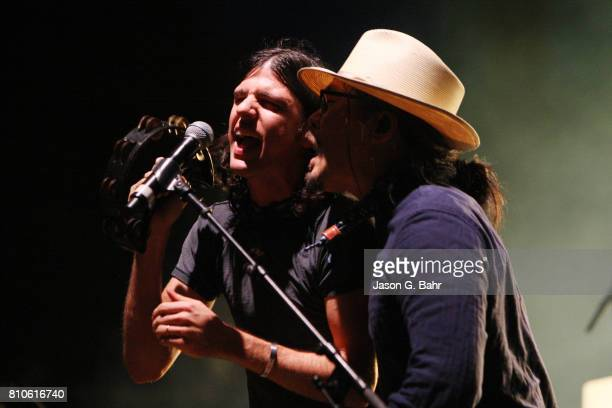 Seth Avett and Joe Kwon of The Avett Brothers perform at Red Rocks Amphitheatre on July 7 2017 in Morrison Colorado