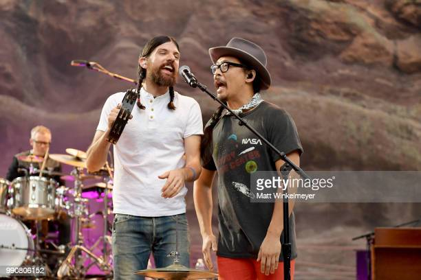 MORRISON CO JULY 1 Seth Avett and Joe Kwon of The Avett Brothers perform at Red Rocks Amphitheatre on July 1 2018 in Morrison Colorado