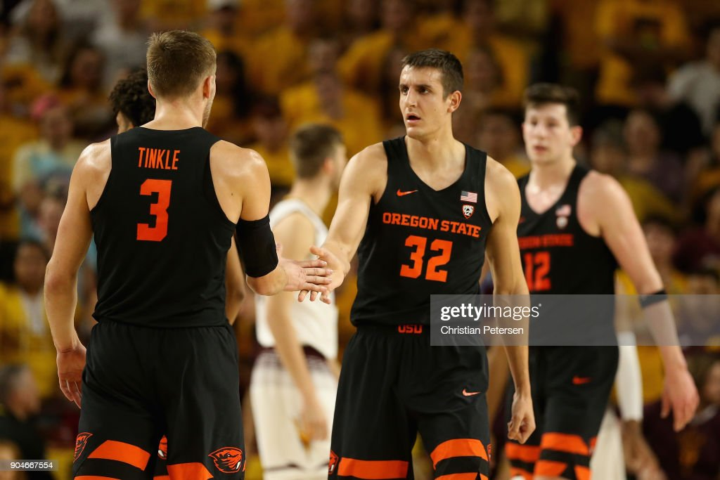 Seth Berger #32 of the Oregon State Beavers high fives Tres Tinkle #3 after scoring against the Arizona State Sun Devils during the second half of the college basketball game at Wells Fargo Arena on January 13, 2018 in Tempe, Arizona. The Sun Devils defeated the Beavers 77-75.
