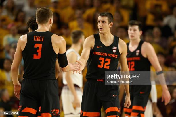 Seth Berger of the Oregon State Beavers high fives Tres Tinkle after scoring against the Arizona State Sun Devils during the second half of the...