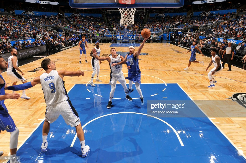 Seth Curry #30 of the Dallas Mavericks shoots the ball against the Orlando Magic during a preseason game on October 5, 2017 at Amway Center in Orlando, Florida.
