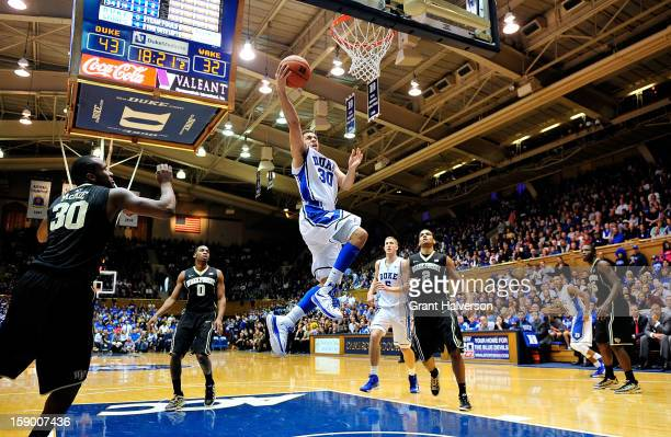 Seth Curry of the Duke Blue Devils drives to the basket for 2 of his 22 points against the Wake Forest Demon Deacons during play at Cameron Indoor...