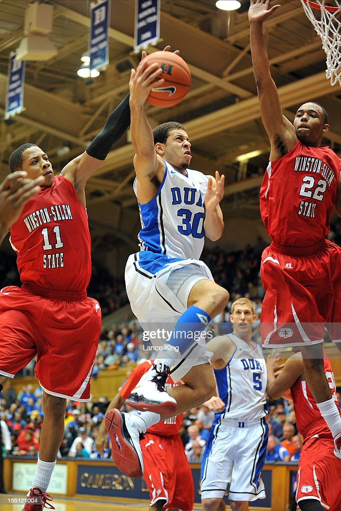 Seth Curry #30 of the Duke Blue Devils goes to the hoop against Justin Glover #11 and WyKevin Bazemore #22 of the Winston-Salem State Rams at Cameron Indoor Stadium on November 1, 2012 in Durham, North Carolina. Duke defeated Winston-Salem State 69-44.