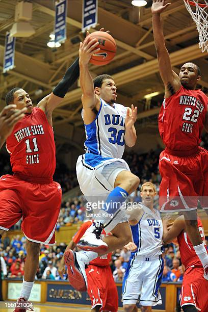 Seth Curry of the Duke Blue Devils goes to the hoop against Justin Glover and WyKevin Bazemore of the WinstonSalem State Rams at Cameron Indoor...