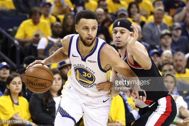 Seth Curry of the Portland Trail Blazers defends Stephen Curry of the Golden State Warriors during the first half in game one of the NBA Western...