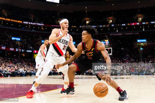 Seth Curry of the Portland Trail Blazers guards Collin Sexton of the Cleveland Cavaliers during the first half at Quicken Loans Arena on February 25...