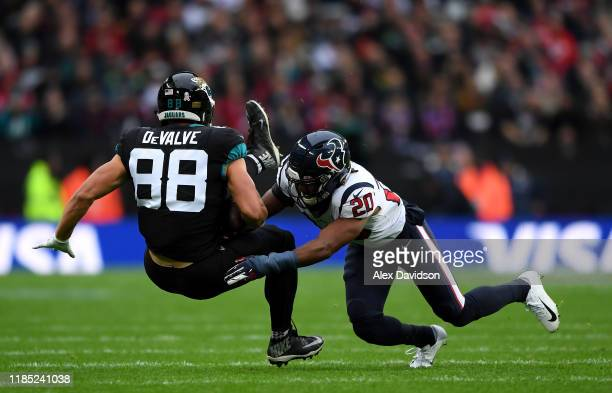 Seth DeValve of Jacksonville Jaguars is tackled by Justin Reid of Houston Texans during the NFL game between Houston Texans and Jacksonville Jaguars...