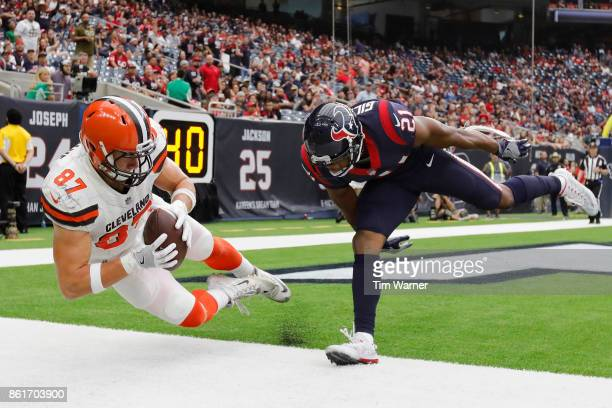 Seth DeValve of the Cleveland Browns catches a pass for a touchdown in the fourth quarter defended by Marcus Gilchrist of the Houston Texans at NRG...