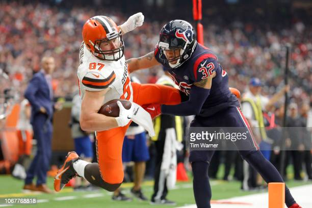 Seth DeValve of the Cleveland Browns is forced out of bounds near the goal line in the third quarter by Tyrann Mathieu of the Houston Texans at NRG...