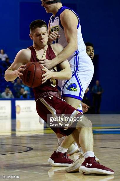 Seth Fuller of the Elon Phoenix runs into Jacob Cushing of the Delaware Fightin Blue Hens during the first half at the Bob Carpenter Center on...