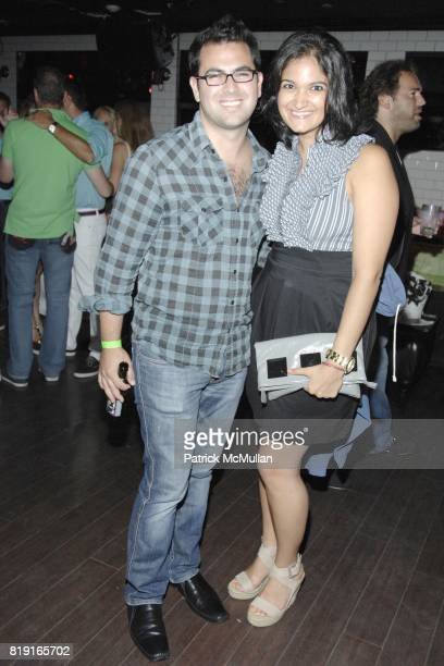 Seth Ginzberg and Nina Sonaolian attend Nic Roldan, Shamin Abas and Tracy Mourning Host Hamptons Social Series Dinner For St. Jude's at Lily Pond on...