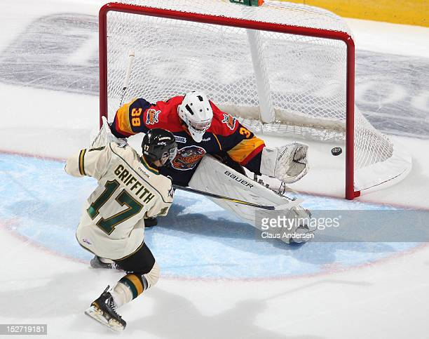 Seth Griffith of the London Knights gets a shot away point blank on Oscar Dansk of the Erie Otters in an OHL game on September 21 2012 at the...