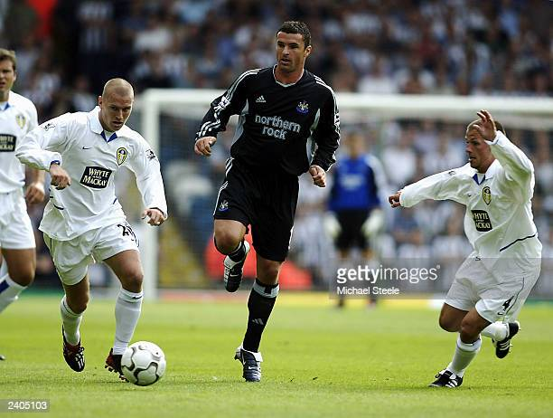 Seth Johnson of Leeds Gary Speed of Newcastle and Jody Morris of Leeds in action during the FA Barclaycard Premiership match between Leeds United and...