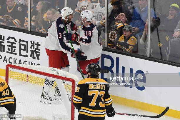 Seth Jones and PierreLuc Dubois of the Columbus Blue Jackets celebrate the overtime goal against the Boston Bruins at the TD Garden on January 2 2020...