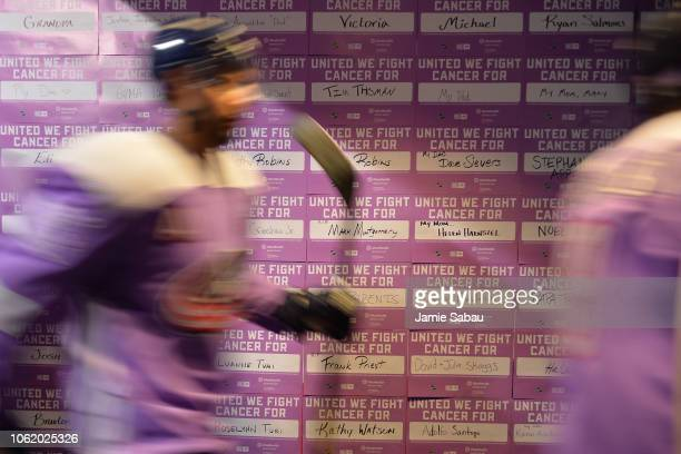 Seth Jones and the Columbus Blue Jackets sport purple jerseys for Hockey Fights Cancer Night as they take the ice for pregame warm ups prior to a...