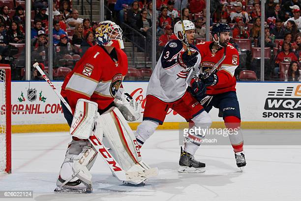 Seth Jones of the Columbus Blue Jackets battles tim Keith Yandle as he tries to get into position in front of goaltender Roberto Luongo of the...