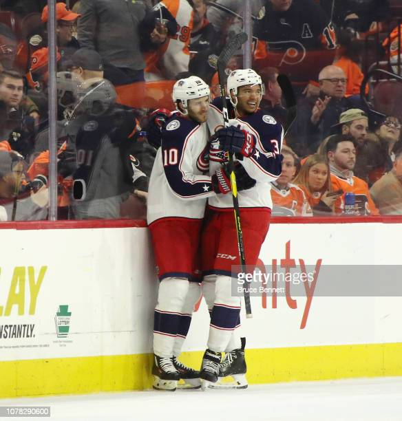 Seth Jones of the Columbus Blue Jackets celebrates his game winning goal at 10 seconds of overtime against the Philadelphia Flyers and is joined by...