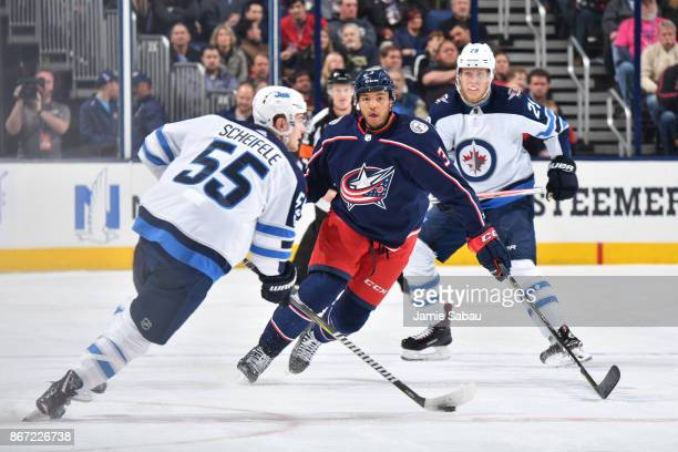 Seth Jones of the Columbus Blue Jackets defends Mark Scheifele of the Winnipeg Jets during the first period of a game on October 27 2017 at...