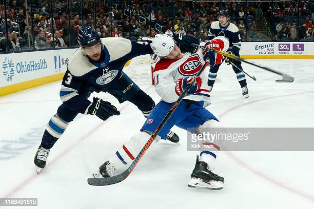 Seth Jones of the Columbus Blue Jackets grabs Brendan Gallagher of the Montreal Canadiens while chasing after the puck during the first period on...