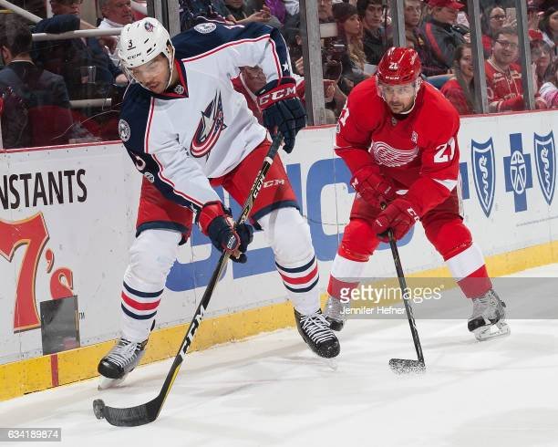Seth Jones of the Columbus Blue Jackets handles the puck as Tomas Tatar of the Detroit Red Wings pressures him during an NHL game at Joe Louis Arena...