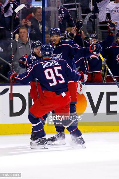 Seth Jones of the Columbus Blue Jackets is congratulated by Cam Atkinson and Matt Duchene after scoring a goal during the second period of Game Four...