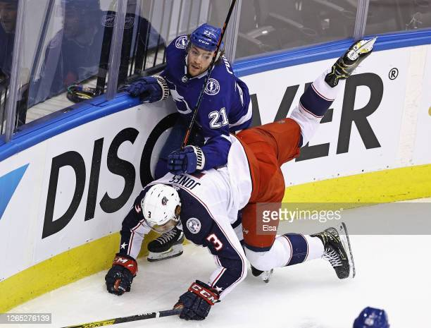 Seth Jones of the Columbus Blue Jackets is tripped up as he hits Brayden Point of the Tampa Bay Lightning during the first period in Game One of the...