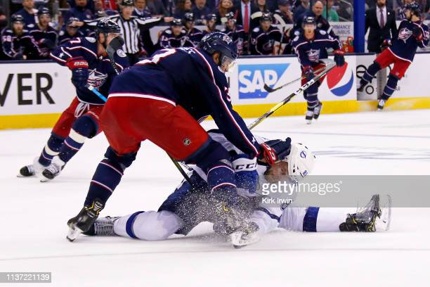 Seth Jones of the Columbus Blue Jackets knocks down Erik Cernak of the Tampa Bay Lightning during the third period of Game Three of the Eastern...